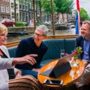 Зачем Тим Кук посетил Амстердам